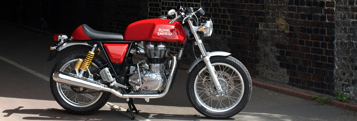 A red Royal Enfield GT parked on centre stand. This area can hold a lot more text. Ideally we want just enough to look good on the image but not too much that it exceeds the available area.
